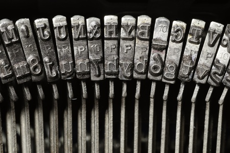 Close-up of old typewriter letter and symbol keys Archivio Fotografico