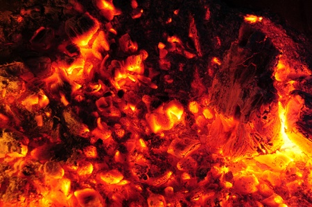Burning embers in a molten fire Stock Photo