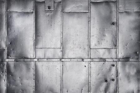 Metal panels on industrial door or wall