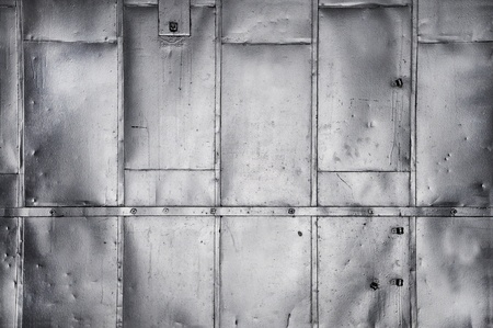 Metal panels on industrial door or wall