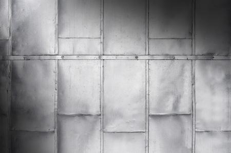 Metal panels on industrial door or wall lit diagonally Banque d'images