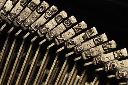Close-up of the striking surface of old typewriter letter and symbol keys photo