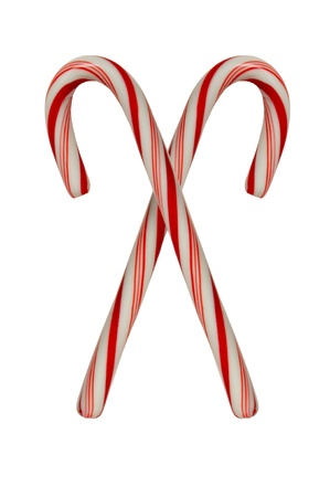 Two crossed candy canes on white background