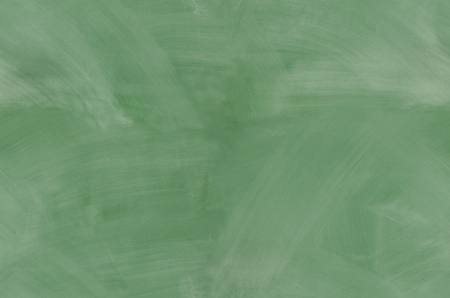 Green chalkboard with smeared chalk eraser marks seamlessly tileable