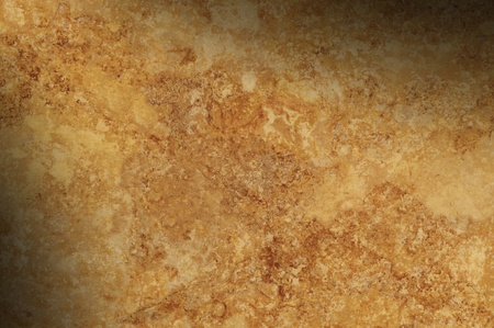 Brown mottled background surface texture lit diagonally Imagens