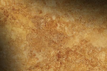 mottled: Brown mottled background surface texture lit diagonally Stock Photo