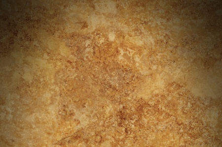 Brown mottled background surface texture lit from above