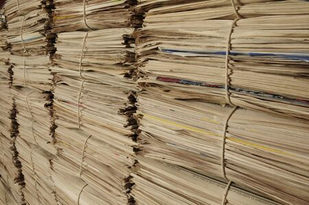 Close-up of piles of newspapers on an angle to be recycled
