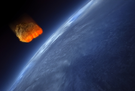 Meteorite heating up as it fall into the Earth's atmosphere. The heat is caused by friction.