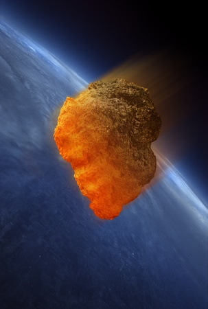 Meteorite heating up as it fall into the Earths atmosphere. The heat is caused by friction.  Stock Photo