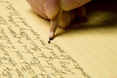 Handwriting with broken pencil point on yellow legal pad