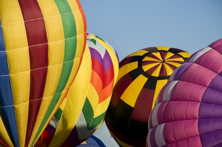 inflated: Several hot-air balloons being inflated Stock Photo