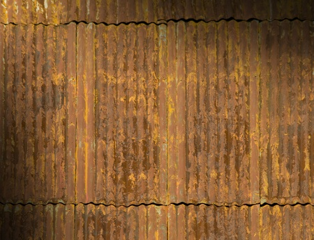 panel: Corroded and rusty corrugated metal roof panels lit diagonally Stock Photo