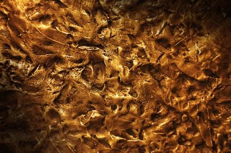 Close-up on a bronze surface texture lit diagonally Stok Fotoğraf