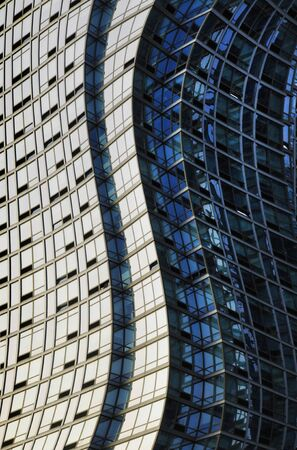 distort: Twisted or warped glass and steel skyscraper structure Stock Photo