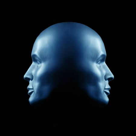 Two-faced head statue in blue light Stock Photo