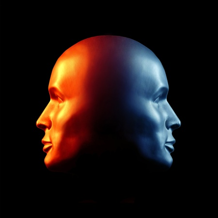 deceit: Two-faced head statue suggesting extremes or split personality. Fire & Ice. Stock Photo