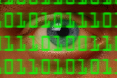 snoop: Close-up of eyeball watching digital binary code Stock Photo
