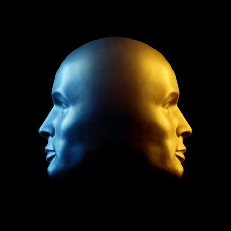 Two-faced head statue with one face gold, the other blue.