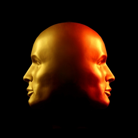 Two-faced head statue with one face gold, the other red.