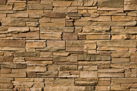 Irregular sized brown bricks with an organic feel. Image is seamlessly tileable Stock Photo
