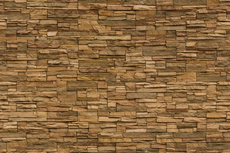 Irregular sized brown bricks with an organic feel. Image is seamlessly tileable Standard-Bild