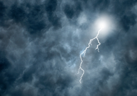 Lightning Bolt coming from Dark Storm Clouds Stock Photo