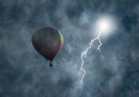 perilous: Lightning bolt coming from dark storm clouds toward hot-air balloon