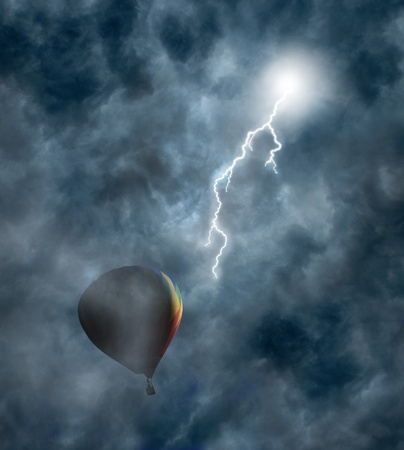 Lightning bolt coming from dark storm clouds toward hot-air balloon photo