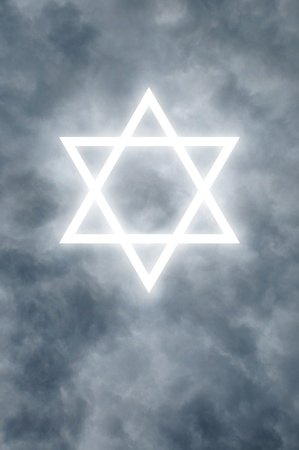 Glowing Star of David among dark clouds Stock Photo