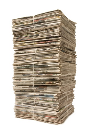 towering: Towering stack of bound newspapers for recycling Stock Photo
