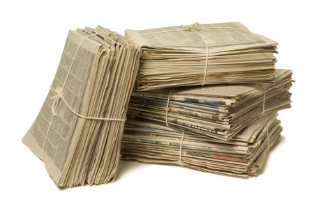 Bundles of bound newspapers for recycling photo