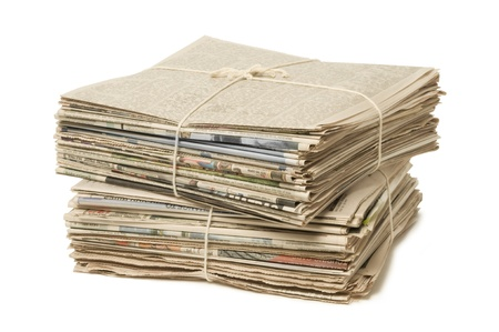 pile reuse: Stack of two newspaper bundles for recycling against white