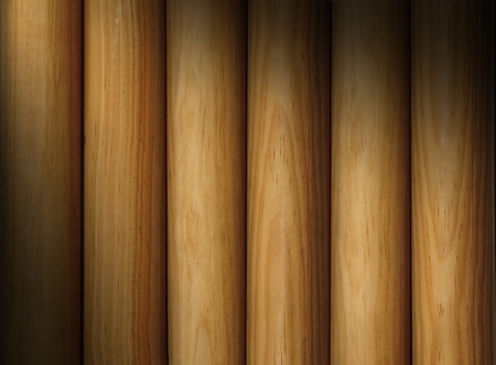 dowel: Wooden poles forming a background texture lit diagonally