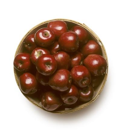 bushel: Bushel basket of Red Delicious apples isolated on white background