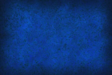 Grungy dark blue mottled background surface texture