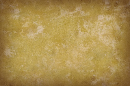 Grungy yellowish mottled background surface texture