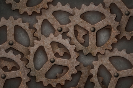 tarnish: Distressed interlocking metal gears Stock Photo