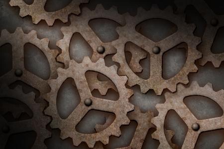tarnish: Distressed interlocking industrial metal gears lit diagonally
