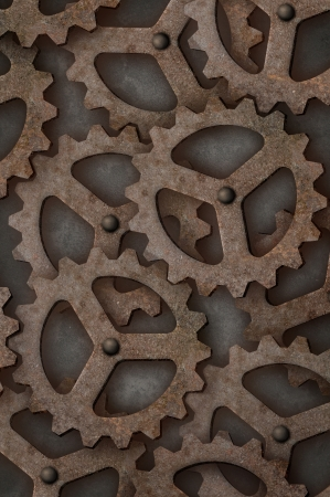 Distressed interlocking industrial metal gears Vertical photo