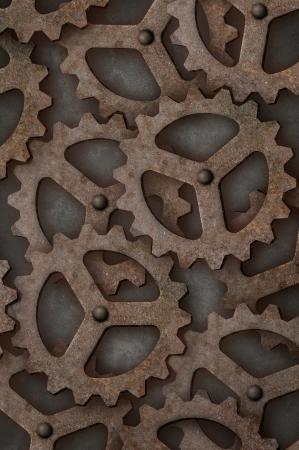 tarnished: Distressed interlocking industrial metal gears Vertical Stock Photo