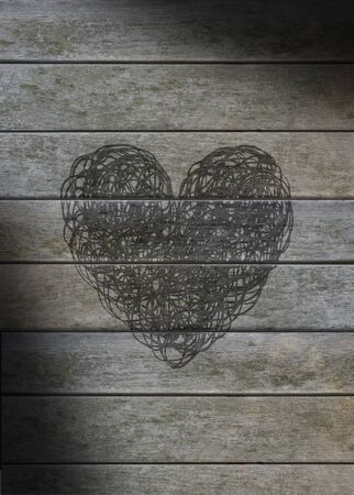 gray: Heart scribbled on a gray weathered wood background