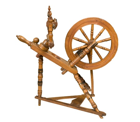 wheel spin: Antique spinning wheel against white background