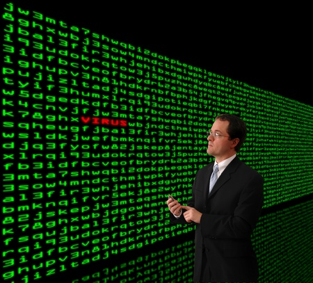 Man in a suit detecting computer virus in a firewall of machine code photo