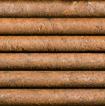 tileable: Horizontal rusty pipe background texture seamlessly tileable Stock Photo