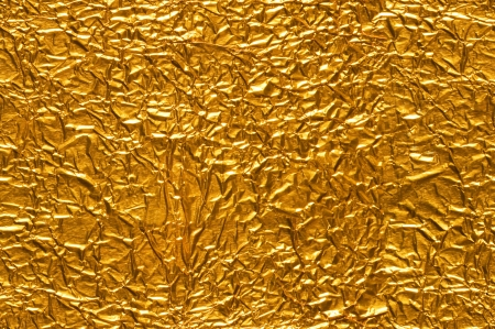tileable: Gold Foil Background Seamlessly tileable Stock Photo