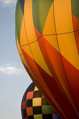envelops: Close-up of the colorful envelops of two hot-air balloons