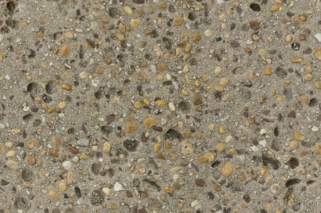 tileable: Distressed concrete surface with imbedded pebbles seamlessly tileable