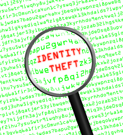 The words Identity Theft revealed in computer machine code through a magnifying glass in high-key photo