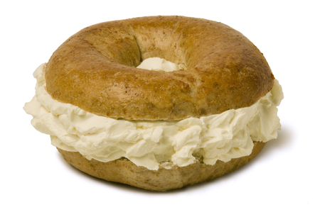 Whole wheat bagel filled with a generous amount of cream cheese